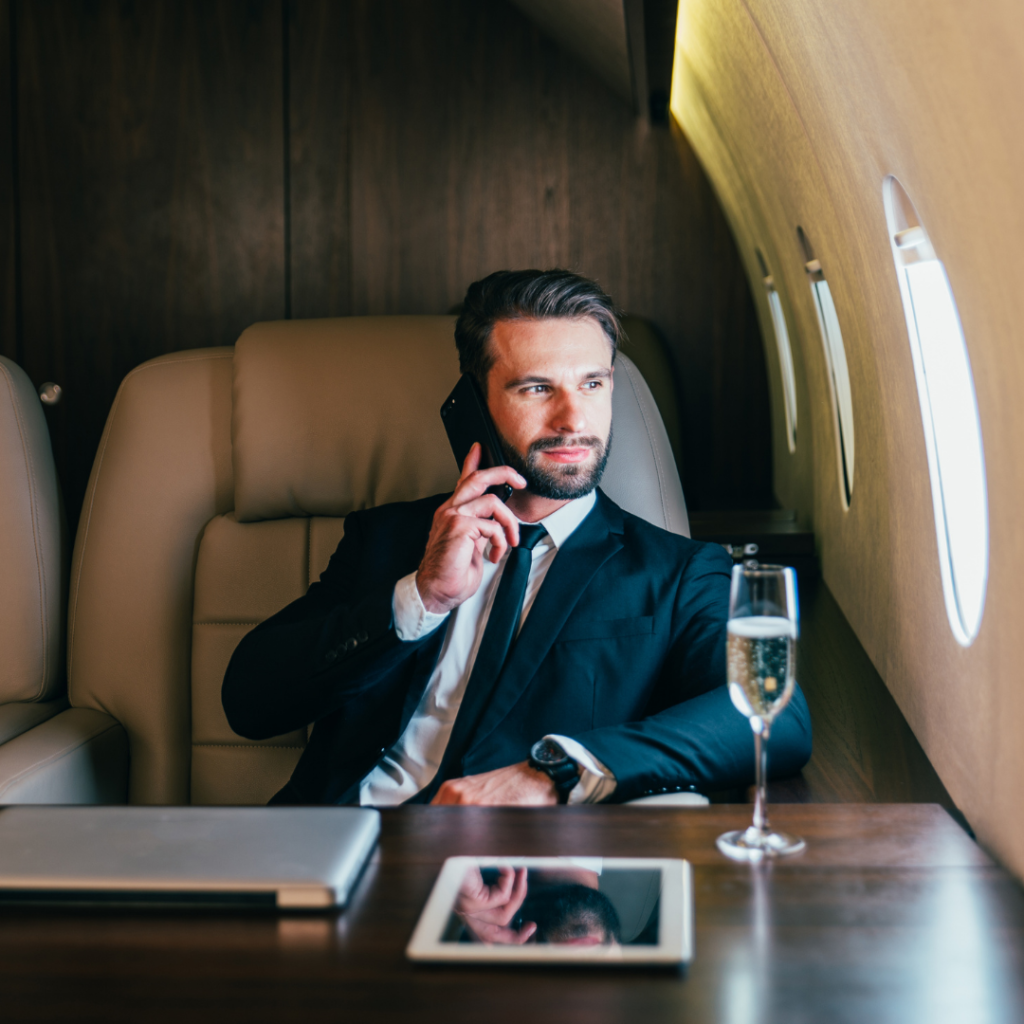 a rich man on a private jet making a call