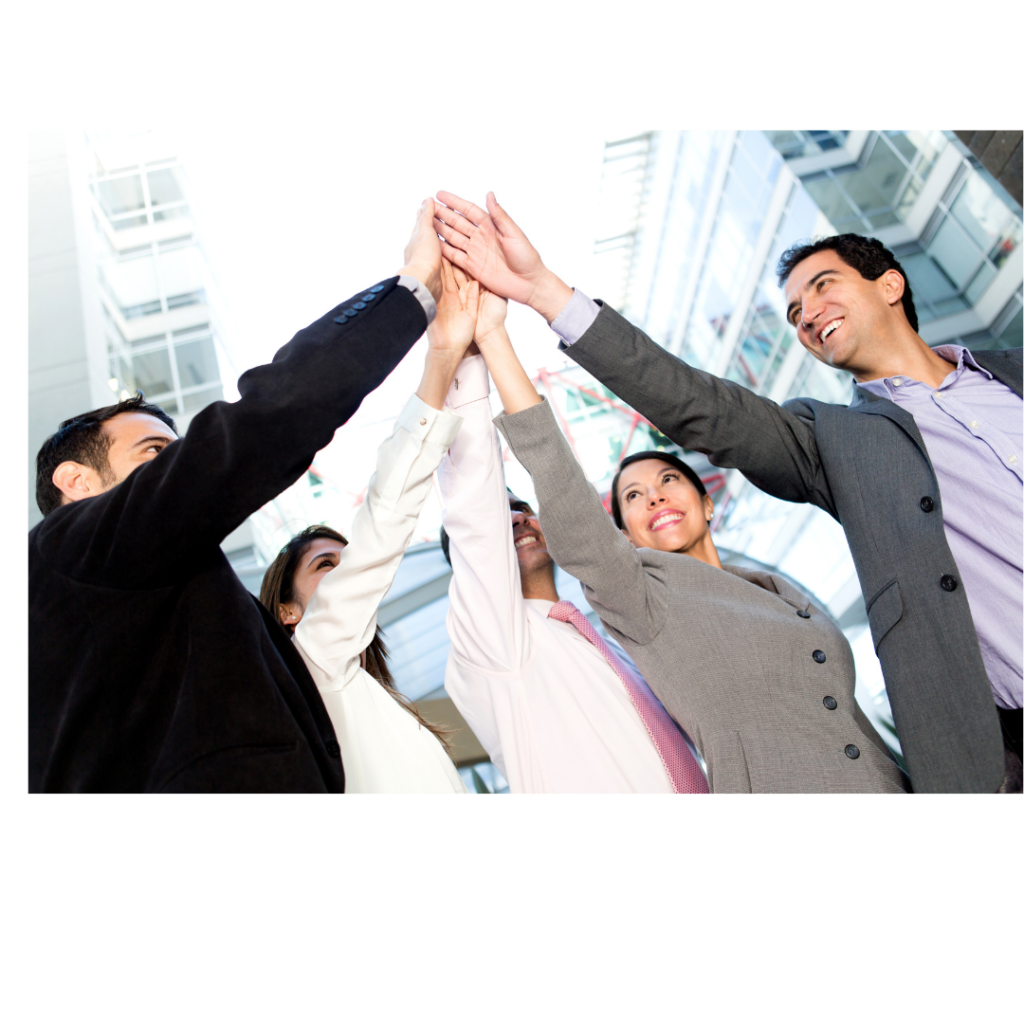 a group of people raising their hands to success